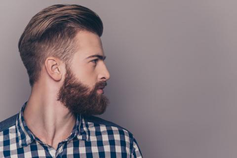 man with stylish hair cut and groomed beard